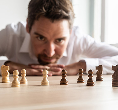 Man thinking about chess strategy